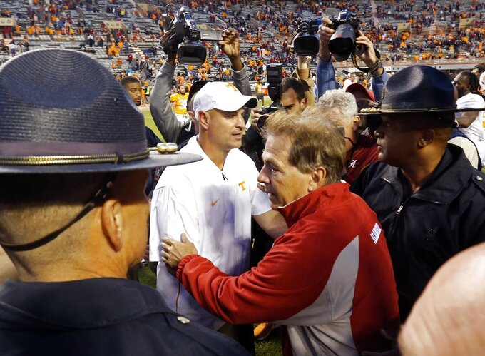 Tennessee head coach Jeremy Pruitt, left, and Alabama head coach Nick Saban meet on the field after an NCAA college football game Saturday, Oct. 20, 2018, in Knoxville, Tenn. Alabama won 58-21. (AP Photo/Wade Payne)
