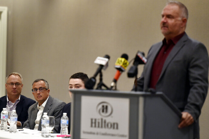 AttorMike Heil, left, and Jim Pliska listen as John Patchcoski speaks of the abuse the three suffered from Father Michael Pulicare, during a press conference Wednesday, Ayg. 28,2019, in Scranton, Pa., about their lawsuits against the Roman Catholic Diocese of Scranton. (Aimee Dilger/The Times Leader via AP)