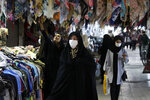 People shop at the old grand bazaar of the city of Zanjan, as some of them wear protective face masks to help prevent the spread of the coronavirus, some 330 kilometers (205 miles) west of the capital Tehran, Iran, Sunday, July 5, 2020. Iran on Sunday instituted mandatory mask-wearing as fears mount over newly spiking reported deaths from the coronavirus, even as its public increasingly shrugs off the danger of the COVID-19 illness it causes. (AP Photo/Vahid Salemi)