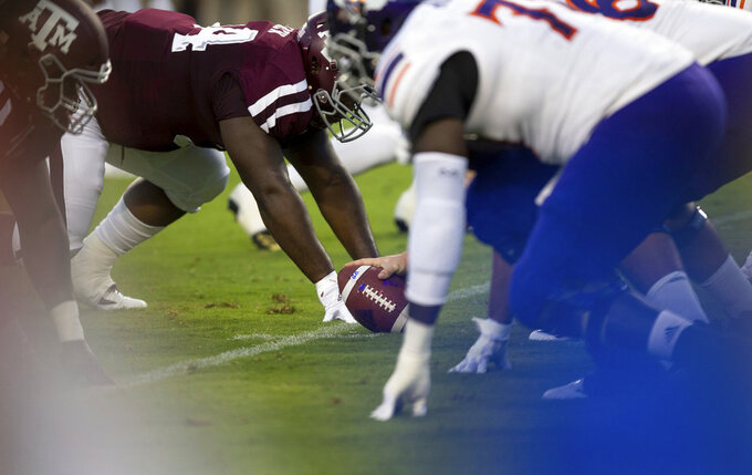 Texas A&M defenders line up against Northwestern State with the ball spotted at the 25-yard line after a fair catch was called on the opening kickoff of an NCAA college football game Thursday, Aug. 30, 2018, in College Station, Texas. Under a new rule, if a fair catch is made on a kick inside the 25, it's a touchback. A fair catch beyond the 25 is marked at that spot, like on a punt. A muffed fair catch also is marked at the spot regardless of which team recovers. The purpose is to increase the number of touchbacks on kickoffs as a way to enhance player safety. Research has shown kick returns are among the most dangerous plays. (AP Photo/Sam Craft)