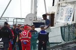 A migrant disembarks the Alan Kurdi rescue ship docked in the port of Taranto, Italy, Sunday, Nov. 3,  2019. He was among 88 people aboard the Alan Kurdi, a ship operated by the Germany Sea-Eye humanitarian group, rescued in the Mediterranean Sea north of Libya and disembarked Sunday in the port of Taranto. (Renato Ingenito/ANSA via AP)