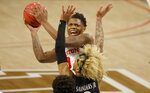 Houston guard Marcus Sasser (0) goes inside to shoot as Cincinnati guard Mike Saunders (3) defends during the first half of an NCAA college basketball game in the final round of the American Athletic Conference men's tournament Sunday, March 14, 2021, in Fort Worth, Texas. (AP Photo/Ron Jenkins)