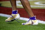 San Francisco 49ers' Dante Pettis wears cleats honoring Kobe Bryant before the NFL Super Bowl 54 football game between the San Francisco 49ers and Kansas City Chiefs Sunday, Feb. 2, 2020, in Miami Gardens, Fla. (AP Photo/Patrick Semansky)