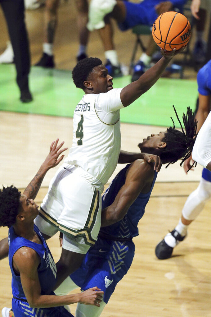 Colorado State guard Isaiah Stevens (4) fouls Buffalo forward Jeenathan Williams, right, as he goes up for a shot during the first half of an NCAA college basketball game in the NIT, Friday, March 19, 2021, in Denton, Texas. (AP Photo/Richard W. Rodriguez)