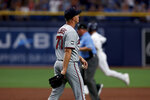 Minnesota Twins starting pitcher Andrew Albers (77) heads back to mound after giving up a home run to the Tampa Bay Rays during the second inning of a baseball game on Saturday, Sept. 4, 2021, in St. Petersburg, Fla. (AP Photo/Scott Audette)