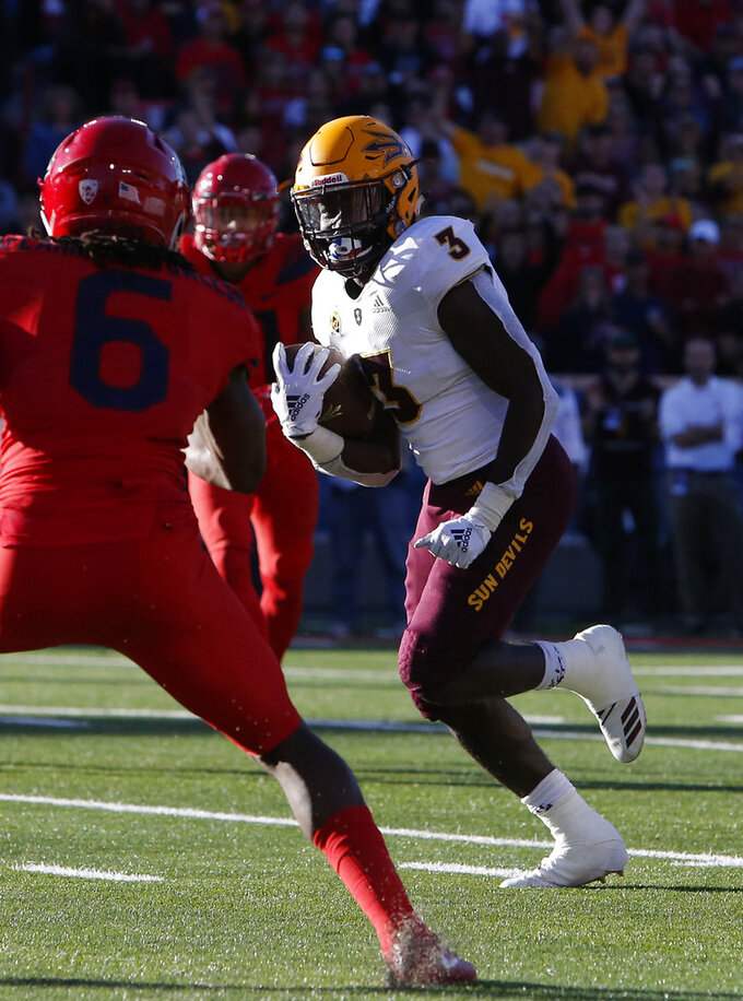 Arizona State running back Eno Benjamin (3) scores a touchdown in front of Arizona safety Demetrius Flannigan-Fowles in the second half during an NCAA college football game, Saturday, Nov. 24, 2018, in Tucson, Ariz. (AP Photo/Rick Scuteri)