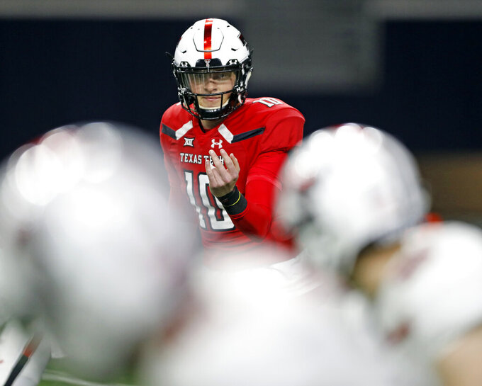 Texas Tech's Alan Bowman (10) calls over Brandt Schilling (80) during an NCAA college football spring game, Saturday, April 13, 2019, in Frisco, Texas. (Brad Tollefson/Lubbock Avalanche-Journal via AP)