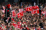 Fans gather to watch as Liverpool soccer team ride an open top bus during the Champions League Cup Winners Parade through the streets of Liverpool, England, Sunday June 2, 2019.  Liverpool is champion of Europe for a sixth time after beating Tottenham 2-0 in the Champions League final played in Madrid Saturday. (Richard Sellers/PA via AP)