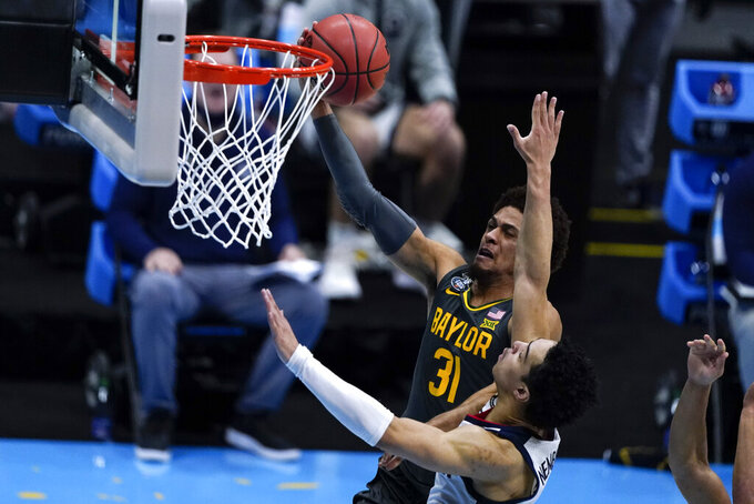Baylor guard MaCio Teague (31) shoots over Gonzaga forward Anton Watson during the first half of the championship game in the men's Final Four NCAA college basketball tournament, Monday, April 5, 2021, at Lucas Oil Stadium in Indianapolis. (AP Photo/Michael Conroy)