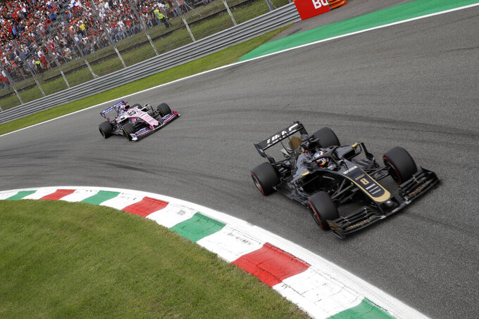 Haas driver Romain Grosjean of France steers his car followed by Racing Point driver Sergio Perez of Mexico during the Formula One Italy Grand Prix at the Monza racetrack, in Monza, Italy, Sunday, Sept. 8, 2019. (AP Photo/Luca Bruno)