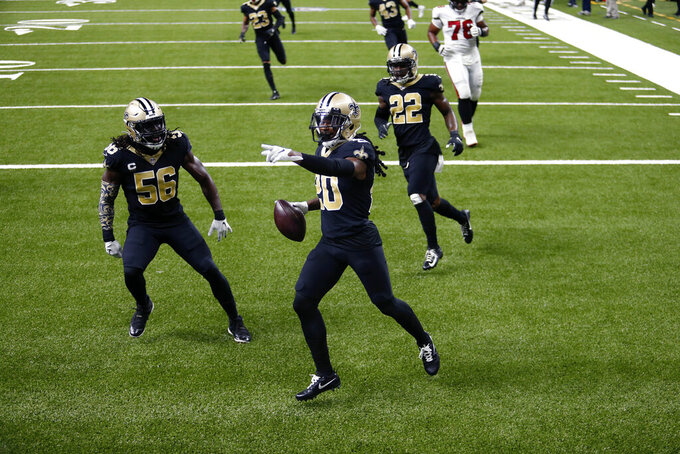 New Orleans Saints cornerback Janoris Jenkins (20) celebrates his pick six with outside linebacker Demario Davis (56) and safety Chauncey Gardner-Johnson (22) in the second half of an NFL football game against the Tampa Bay Buccaneers in New Orleans, Sunday, Sept. 13, 2020. (AP Photo/Brett Duke)