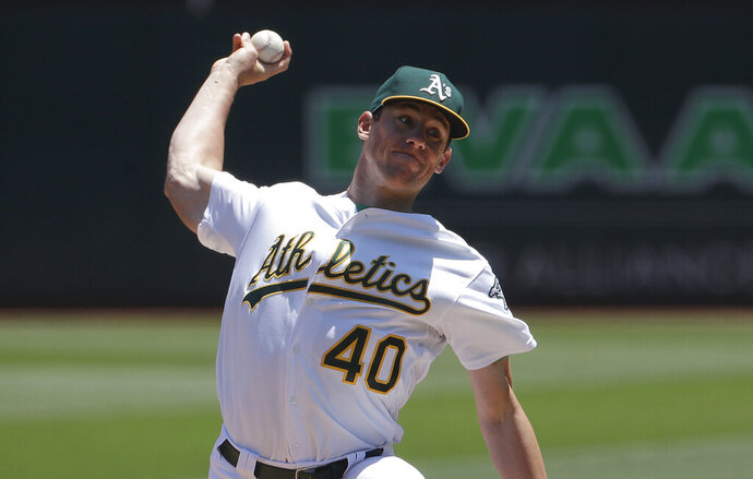 Oakland Athletics pitcher Chris Bassitt (40) throws to a Baltimore Orioles batter during the first inning of a baseball game in Oakland, Calif., Wednesday, June 19, 2019. (AP Photo/Jeff Chiu)