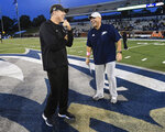 Appalachian State head coach Scott Satterfield and Georgia Southern head coach Chad Lunsford, right, talk before an NCAA college football game, Thursday, Oct. 25, 2018, in Statesboro, Ga. The two rival coaches were roommates while graduate assistants in school at Appalachian State. (AP Photo/John Amis)