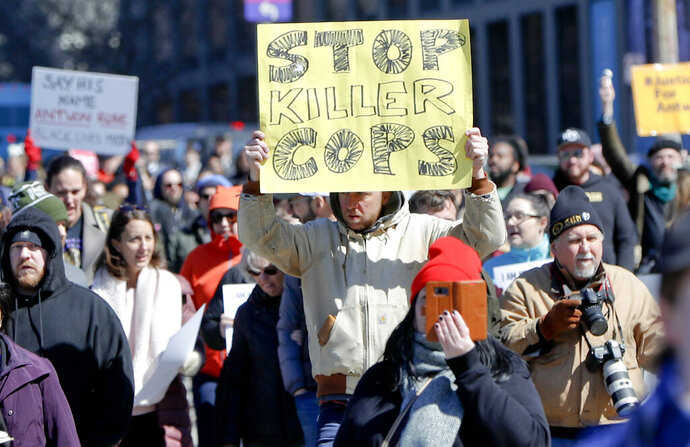 Marchers move through the streets Saturday, March 23, 2019 in Pittsburgh, Pa. The group was calling for justice the day after former East Pittsburgh police officer Michael Rosfeld was acquitted in the homicide trial where he was charged with shooting and killing 17-year-old Antwon Rose II last summer near Pittsburgh. (AP Photo/Keith Srakocic)