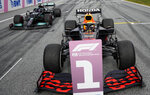 Red Bull driver Max Verstappen of the Netherlands, right, wins ahead of Mercedes driver Lewis Hamilton of Britain, left, the Styrian Formula One Grand Prix at the Red Bull Ring racetrack in Spielberg, Austria, Sunday, June 27, 2021. (AP Photo/Darko Vojinovic, Pool)