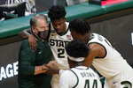 Michigan State coach Tom Izzo talks to guard Rocket Watts (2) and forward Aaron Henry during the second half of the team's NCAA college basketball game against Detroit Mercy, Friday, Dec. 4, 2020, in East Lansing, Mich. (AP Photo/Carlos Osorio)