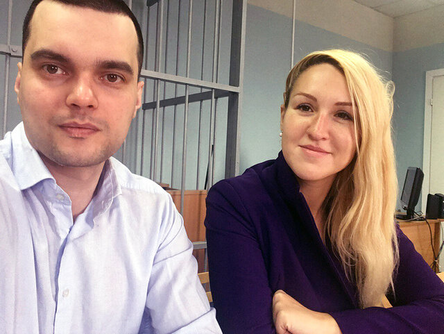 In this handout photo released by the Foundation for Fighting Corruption, Dr. Anastasia Vasilyeva of the Alliance of Doctors union, right, and the Foundation for Fighting Corruption's lawyer Vyacheslav Gimadi sit in court room in Okulovo, Novgorod region, about 400 kilometers (about 250 miles) northwest of Moscow, Russia, Friday, April 3, 2020. An activist doctor who had criticized Russia's response to the coronavirus outbreak was forcibly detained as she and some of her colleagues tried to deliver protective gear to a hospital in need. The new coronavirus causes mild or moderate symptoms for most people, but for some, especially older adults and people with existing health problems, it can cause more severe illness or death. (The Foundation for Fighting Corruption via AP)