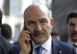 FILE - In this Wednesday, Nov. 5, 2019 file photo, Turkey's Interior Minister Suleyman Soylu speaks on the phone in Ankara, Turkey.  A U.S. national who is a member of the Islamic State group has been deported home on Monday, Nov. 11, 2019, a Turkish official said, and Interior Minister Soylu has said Turkey which holds about 1,200 foreign IS fighters in Turkish prisons, will start repatriating captured foreign IS fighters as of Monday.(AP Photo/Burhan Ozbilici, File)