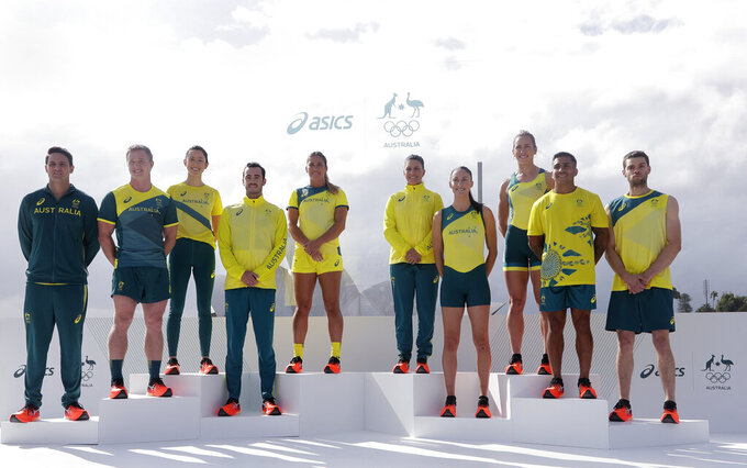 Olympic hopefuls pose for photos in their green and gold competition kits in Sydney, Australia, Wednesday, March 31, 2021, during the unveiling of the uniforms the Australian team will wear during the Tokyo Olympic games. (AP Photo/Rick Rycroft)