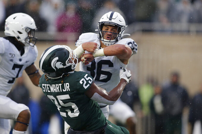 Penn State's Jan Johnson, right, hits Michigan State's Darrell Stewart (25) in the end zone on an attempted pass reception during the second quarter of an NCAA college football game, Saturday, Oct. 26, 2019, in East Lansing, Mich. (AP Photo/Al Goldis)
