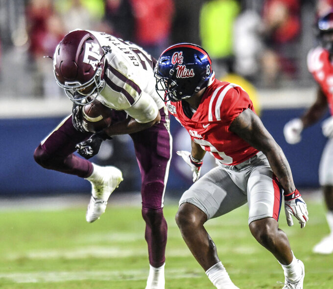 Texas A&M defensive back Clifford Chattman (22) intercepts a pass thrown to Mississippi wide receiver Elijah Moore (8) during an NCAA college football game Saturday, Oct. 19, 2019, in Oxford, Miss,(Bruce Newman/The Oxford Eagle via AP)