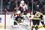 Ottawa Senators' Brady Tkachuk (7) jumps to avoid a shot by teammate Thomas Chabot against Boston Bruins' Tuukka Rask (40) during the second period of an NHL hockey game in Boston, Saturday, March 9, 2019. (AP Photo/Michael Dwyer)