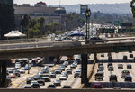 Los Angeles Police officers patrol the ramps over the traffic on the Harbor Freeway for the visit of President Donald Trump in Los Angeles Tuesday, Sept. 17, 2019. Trump began a California visit on Tuesday, saying he will do