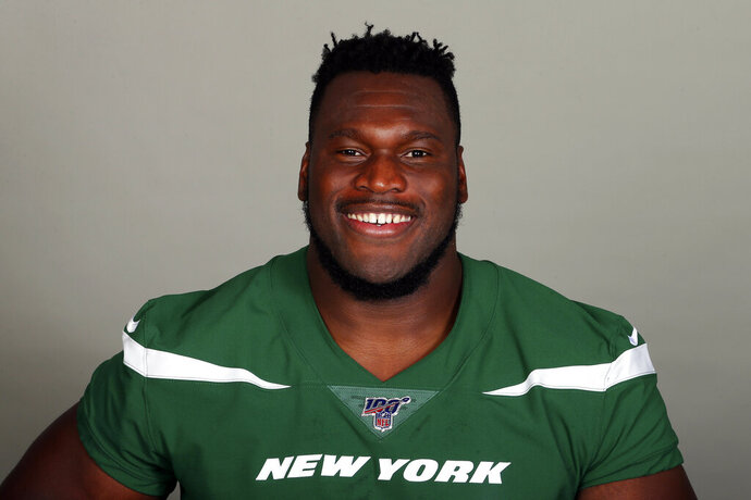 FILE - This is a 2019, file photo, shows Kelechi Osemele of the New York Jets NFL football team. Osemele says he needs season-ending shoulder surgery and is waiting for the team to authorize the procedure. Osemele said Friday, OCt. 18, 2019, that the team doctor and an outside doctor have both recommended the surgery. But a person with direct knowledge of the situation tells The Associated Press both doctors determined it is actually a pre-existing injury and cleared Osemele to play through the injury and not have the surgery until after the season. (AP Photo/File)