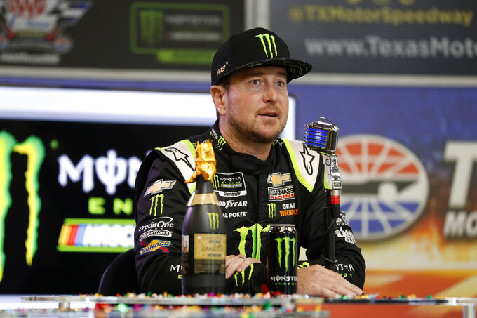 Kurt Busch responds to questions about his new multi-year contract with Chip Ganassi Racing during a NASCAR news conference at Texas Motor Speedway in Fort Worth, Texas, Saturday, Nov. 2, 2019. (AP Photo/Roger Steinman)