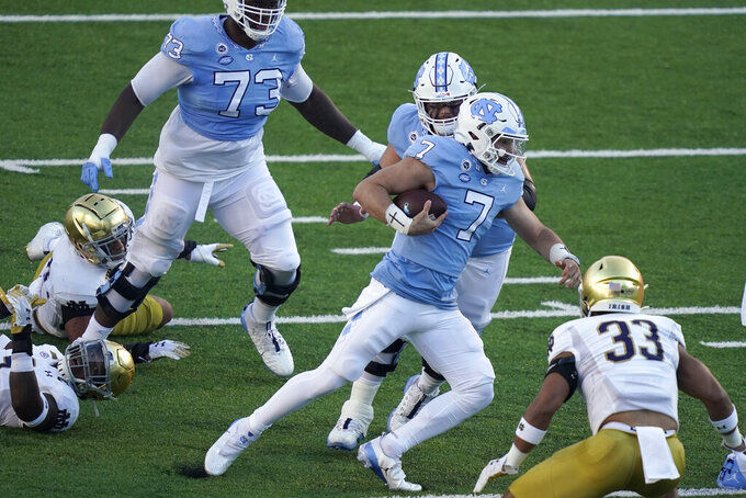 North Carolina quarterback Sam Howell (7) runs against Notre Dame during the first half of an NCAA college football game in Chapel Hill, N.C., Friday, Nov. 27, 2020. (AP Photo/Gerry Broome)