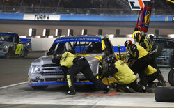 Grant Enfinger makes a pit stop during the NASCAR Truck Series auto race at Phoenix Raceway, Friday, Nov. 6, 2020, in Avondale, Ariz. (AP Photo/Ralph Freso)