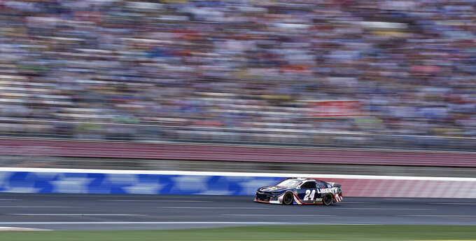 William Byron (24) brings his car through the front stretch during a NASCAR Cup Series auto race at Charlotte Motor Speedway in Concord, N.C., Sunday, May 26, 2019. (AP Photo/Chuck Burton)