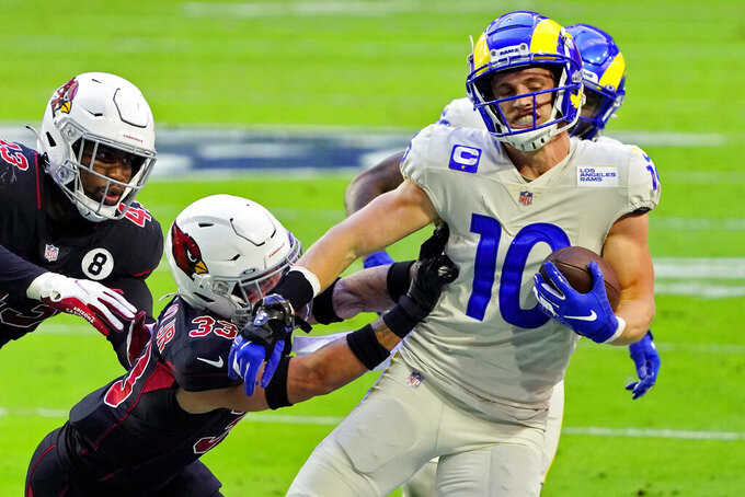 Los Angeles Rams wide receiver Cooper Kupp (10) is hit by Arizona Cardinals cornerback Byron Murphy (33) during the first half of an NFL football game, Sunday, Dec. 6, 2020, in Glendale, Ariz. (AP Photo/Rick Scuteri)