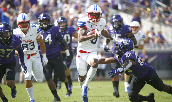 SMU wide receiver Reggie Roberson Jr. (8) runs past TCU safety La'Kendrick Van Zandt (20) after catching a pass for a first down during the first half of an NCAA college football game Saturday, Sept. 21, 2019, in Fort Worth, Texas. (AP Photo/Ron Jenkins)