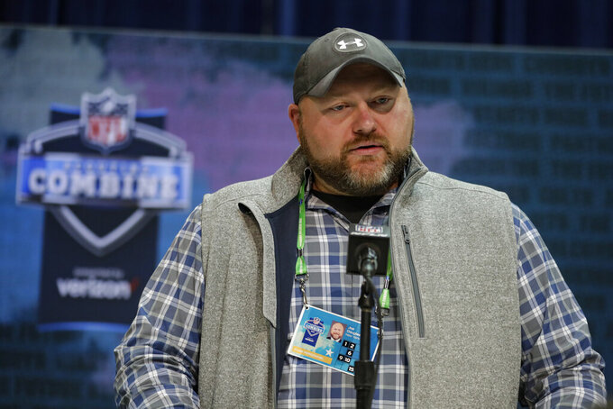 FILE - In this Feb. 25, 2020, file photo, New York Jets general manager Joe Douglas speaks during a news conference at the NFL football scouting combine in Indianapolis. Douglas fully envisioned Jamal Adams being a big piece of what he wants to build for the Jets. The general manager raved about the All-Pro safety's abilities as a playmaker and leader when he took over the franchise just over a year ago. Well, things changed. In a major way. Douglas dealt Adams and a 2022 fourth-round draft pick to Seattle on Saturday, July 25, 2020, for first-rounders in 2021 and '22, a third-rounder in 2021 and safety Bradley McDougald. (AP Photo/Michael Conroy, File)