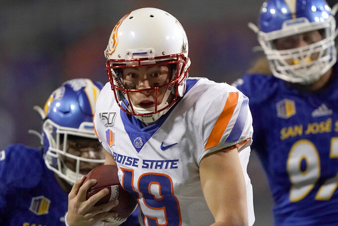 Boise State quarterback Hank Bachmeier (19) rushes for a first down against San Jose State during the second half of an NCAA college football game, in San Jose, Calif., Saturday, Nov. 2, 2019. (AP Photo/Tony Avelar)
