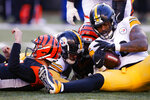 Pittsburgh Steelers outside linebacker Bud Dupree (48) recovers a fumble he forced on Cincinnati Bengals quarterback Ryan Finley, left, for a turnover during the second half an NFL football game, Sunday, Nov. 24, 2019, in Cincinnati. (AP Photo/Gary Landers)