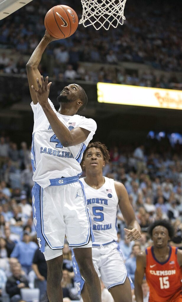 North Carolina's Brandon Robinson (4) drives to the basket in the first an NCAA college basketball game against Clemson on Saturday, Jan. 11, 2020, at the Smith Center in Chapel Hill, N.C. (Robert Willett/The News & Observer via AP)
