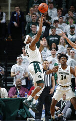 Michigan State's Cassius Winston shoots against Iowa during the first half of an NCAA college basketball game, Tuesday, Feb. 25, 2020, in East Lansing, Mich. (AP Photo/Al Goldis)