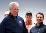 Hall of Fame driver and FOX television announcer Darrell Waltrip laughs with friends as he enters the media center before a press conference announcing his retirement from the booth, before practice for a NASCAR Cup Series auto race, Friday, April 5, 2019, in Bristol, Tenn. Former driver and booth mate Jeff Gordon is to the right. (AP Photo/Wade Payne)