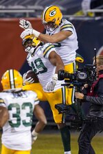 Green Bay Packers' Dominique Dafney is congratulated after catching a touchdown pass during the first half of an NFL football game against the Chicago Bears Sunday, Jan. 3, 2021, in Chicago. (AP Photo/Charles Rex Arbogast)