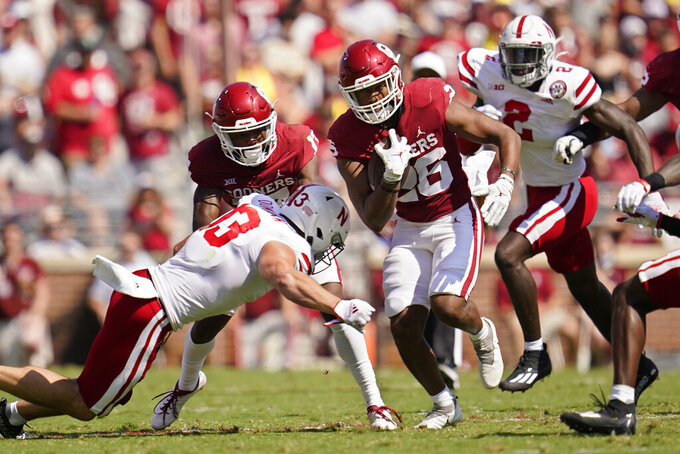 Oklahoma running back Kennedy Brooks (26) carries in the second half of an NCAA college football game against Nebraska, Saturday, Sept. 18, 2021, in Norman, Okla. (AP Photo/Sue Ogrocki)
