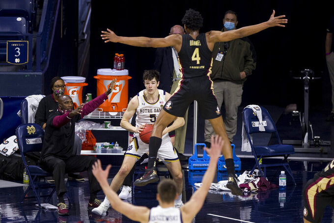 Notre Dame's Cormac Ryan (5) tries to inbound the ball as Florida State's Scottie Barnes (4) pressures him during the second half of an NCAA college basketball game Saturday, March 6, 2021, in South Bend, Ind. Notre Dame won 83-73. (AP Photo/Robert Franklin)