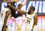 Norfolk State guard Jalen Hawkins (24) reacts after scoring a three-point basket during the first half of a First Four game against Appalachian State in the NCAA men's college basketball tournament, Thursday, March 18, 2021, in Bloomington, Ind. (AP Photo/Doug McSchooler)