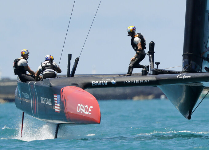 FILE - In this Sunday, June 25, 2017, file photo, Oracle Team USA skipper and helmsman Jimmy Spithill, right, crosses the boat during the eighth race of America's Cup sailing competition against Emirates Team New Zealand, in Hamilton, Bermuda. Spithill has signed on as CEO and helmsman of the United States team in SailGP, giving the global league another former America's Cup champion in its stable of stars. (AP Photo/Gregory Bull, File)