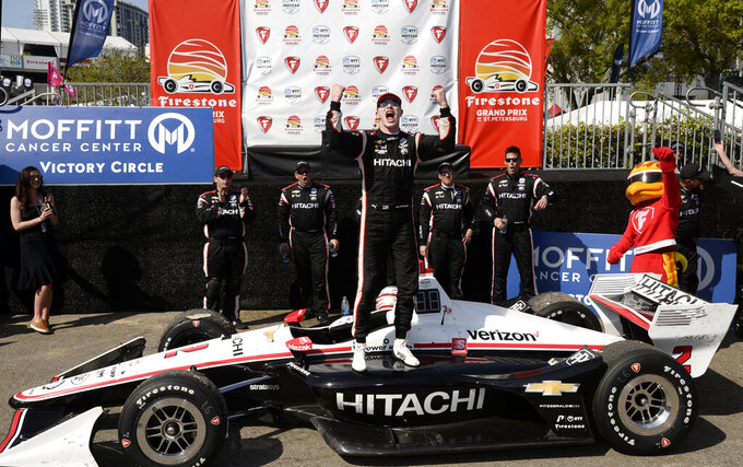 Team Penske driver Josef Newgarden (2), of the United States, celebrates after winning the IndyCar Firestone Grand Prix of St. Petersburg (Fla.) auto race Sunday, March 10, 2019, in St Petersburg, Fla. (AP Photo/Jason Behnken)