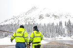 Colorado Department of Transportation officials discuss with each other near Interstate 70 during a snowstorm, Thursday, March 7, 2019, at Loveland Pass, Colo. Historic avalanche danger caused havoc in the Colorado mountains Thursday, shutting down portions of two highways and prompting a rare warning for drivers to avoid a route leading to some of the state's busiest ski resorts.(Hugh Carey/Summit Daily News via AP)