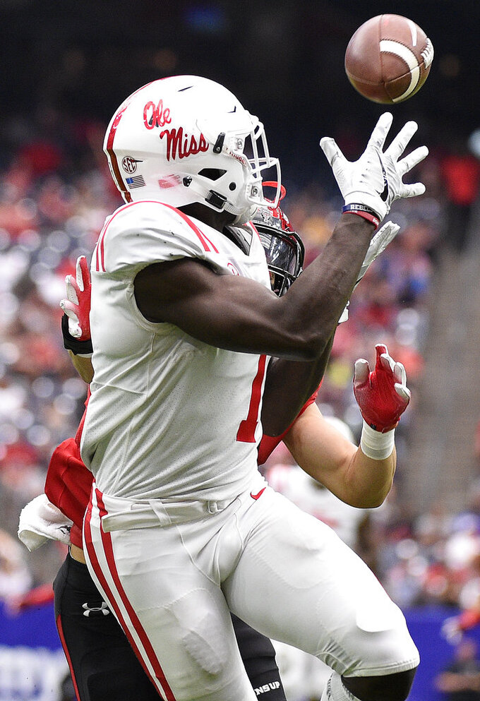 Mississippi wide receiver A.J. Brown catches a touchdown as Texas Tech defensive back Justus Parker defends during the second half of a college football game, Saturday, Sept. 1, 2018, in Houston. Mississippi won 47-27. (AP Photo/Eric Christian Smith)