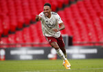 Arsenal's Pierre-Emerick Aubameyang celebrates after scores the winning penalty in a penalty shootout at the end of the English FA Community Shield soccer match between Arsenal and Liverpool at Wembley stadium in London, Saturday, Aug. 29, 2020. (Andrew Couldridge/Pool via AP)