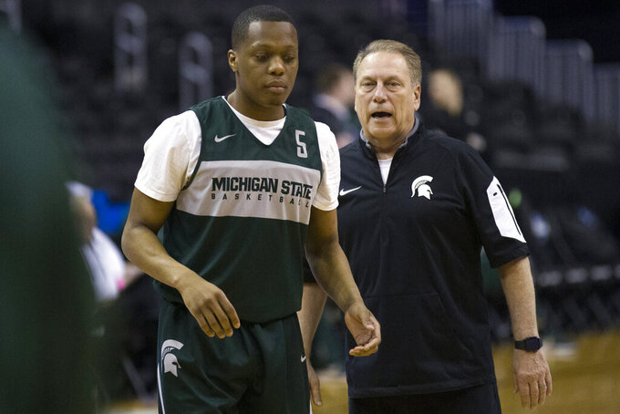 Michigan State's guard Cassius Winston, left, talks with head coach Tom Izzo during practice at the NCAA men's college basketball tournament in Washington, Thursday, March 28, 2019. Michigan State plays LSU in an East Regional semifinal game on Friday. (AP Photo/Alex Brandon)